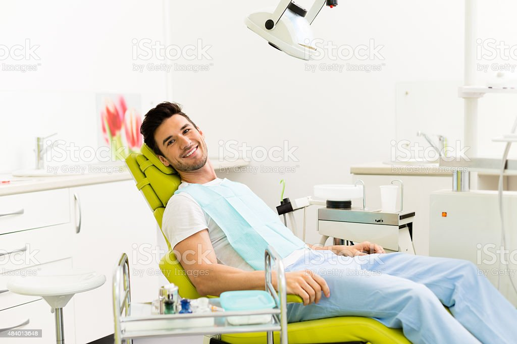 Male patient in the dentist's office stock photo
