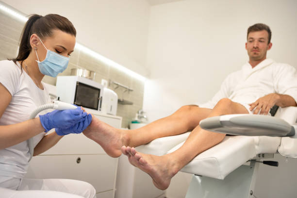 Male patient in the process of hardware pedicure procedure Master chiropody shapes the nails . Male patient in the process of hardware pedicure procedure. Concept body care. Close up pedicure manicure men beauty spa stock pictures, royalty-free photos & images