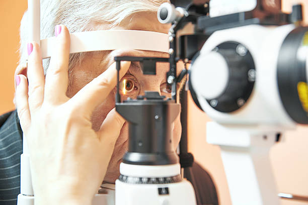 male patient under eye sight examination at ophthalmology clinic stock photo
