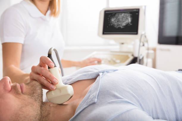 Male Patient Undergoing Ultrasound Of Thyroid Male Patient Undergoing Ultrasound Of Thyroid Gland In Examination Room anode stock pictures, royalty-free photos & images