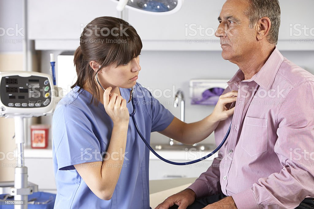 A male patient visiting his general practitioner stock photo