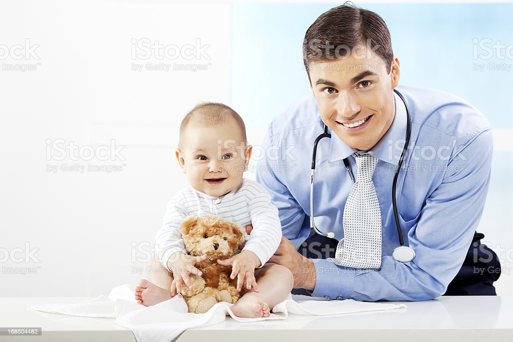 Male Pediatrician friendly potrait with baby patient royalty-free stock photo