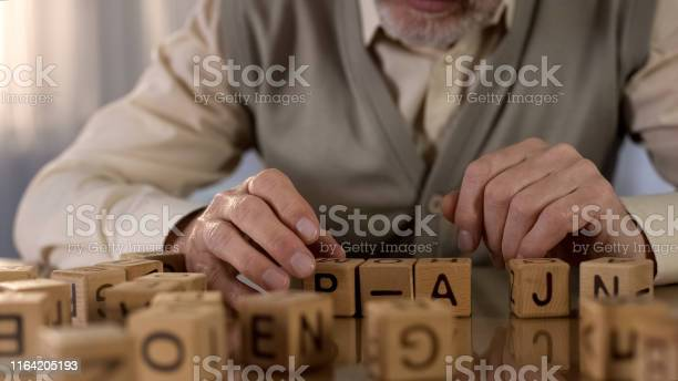 Male pensioner trying to make word of wooden cubes old age dementia picture id1164205193?b=1&k=6&m=1164205193&s=612x612&h=soslbet9 yt4exvbx4ppa450n2tzos4hqyt13ohzqiq=