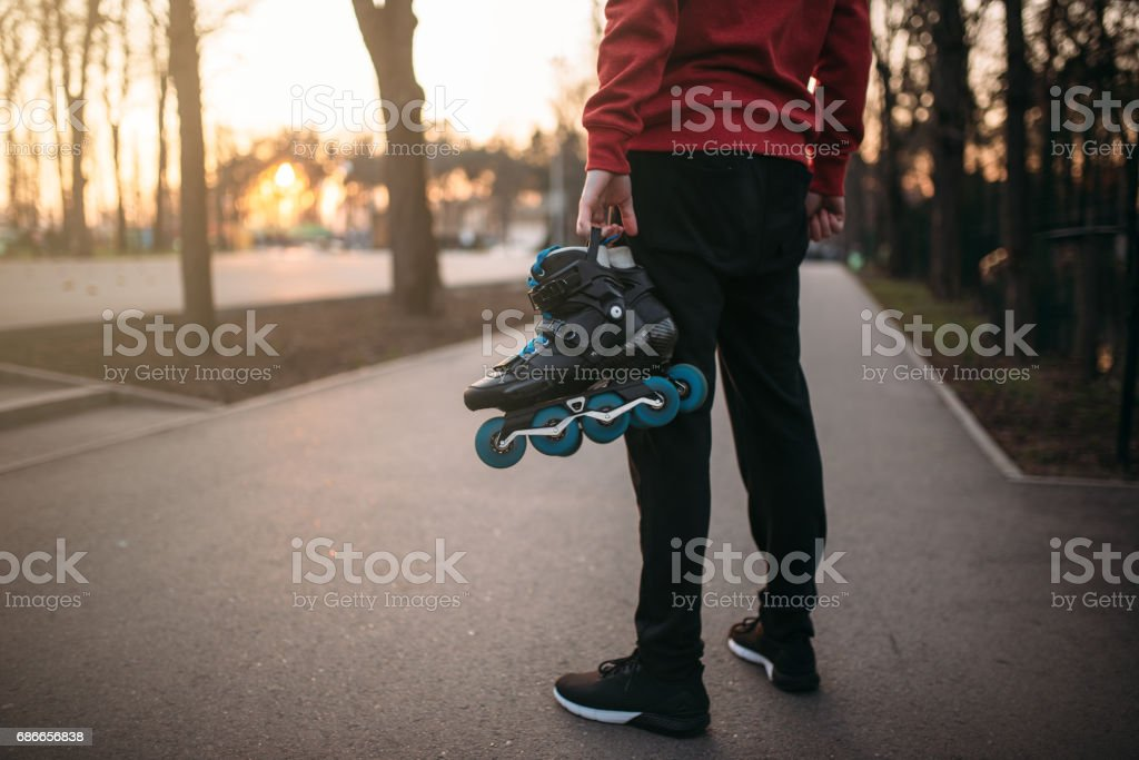 Male person hands with roller skates royalty-free stock photo