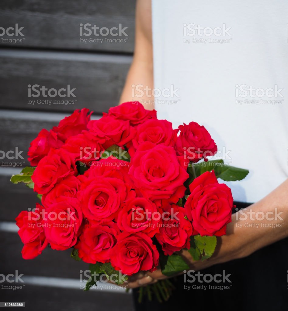 Male Person Holding A Beautiful Bouquet Of Red Roses Wearing White
