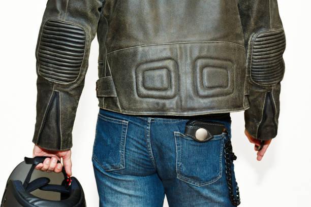 männliche person in motorrad schutzausrüstung - leder portemonnaie herren stock-fotos und bilder