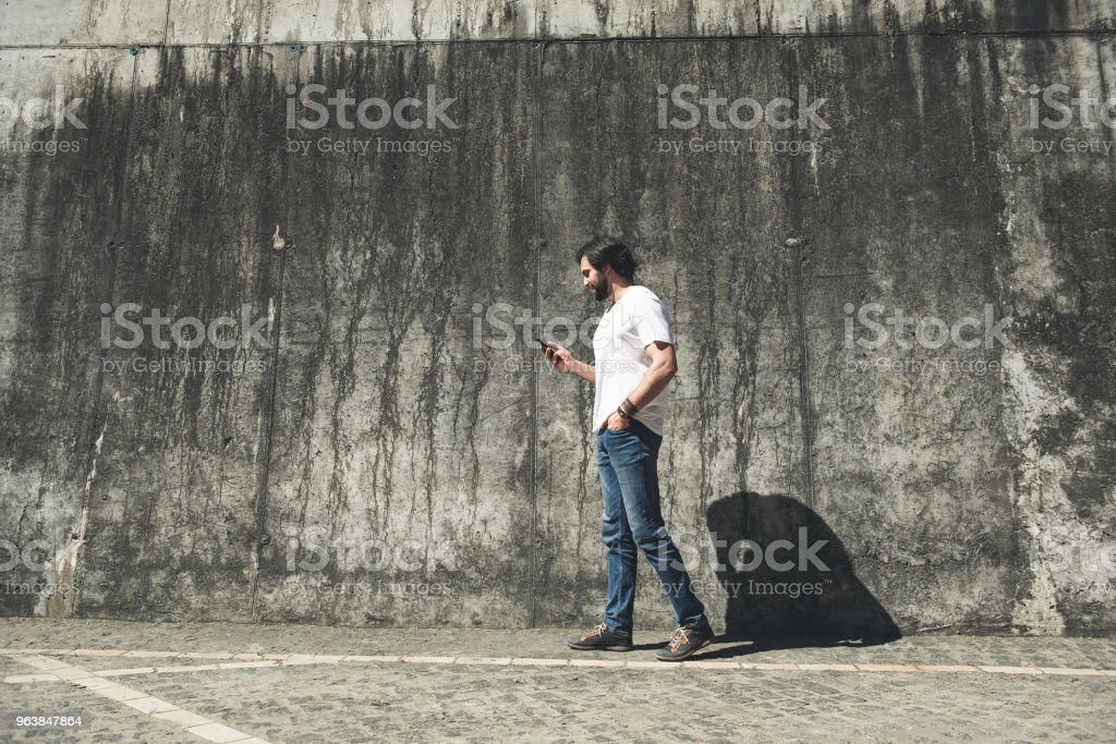 Male person strolling and using modern technology - Royalty-free Adult Stock Photo