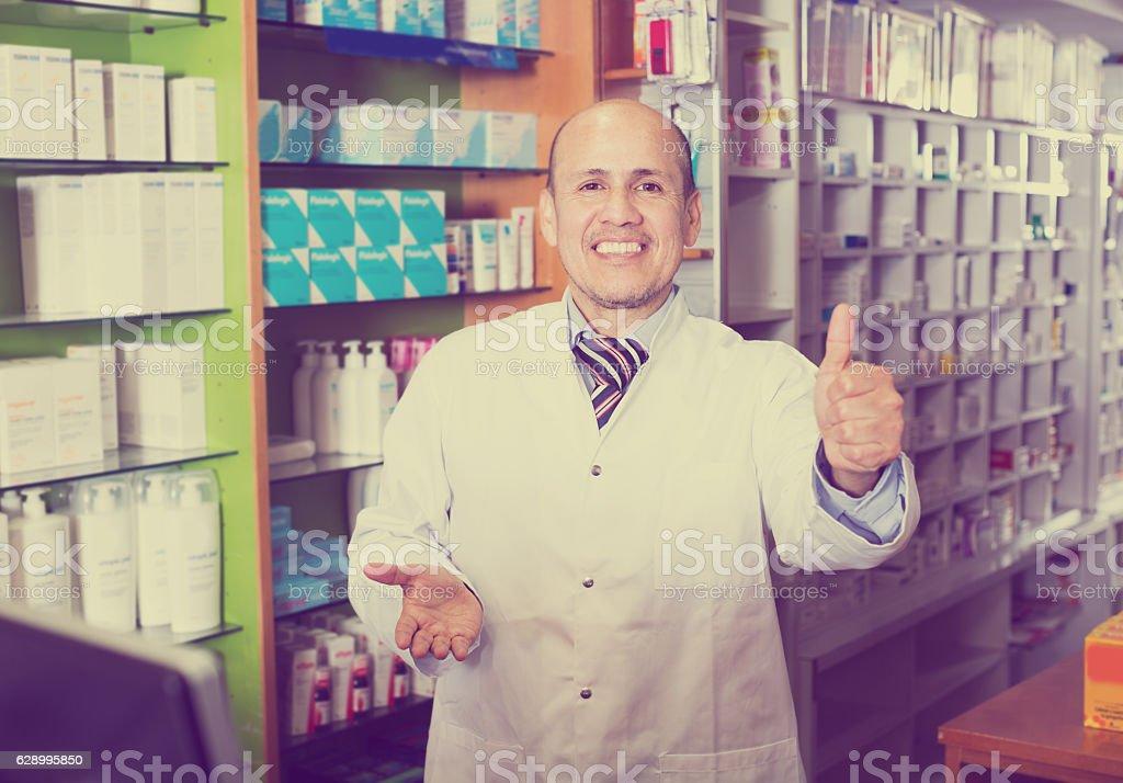 Male pharmacist working in farmacy stock photo