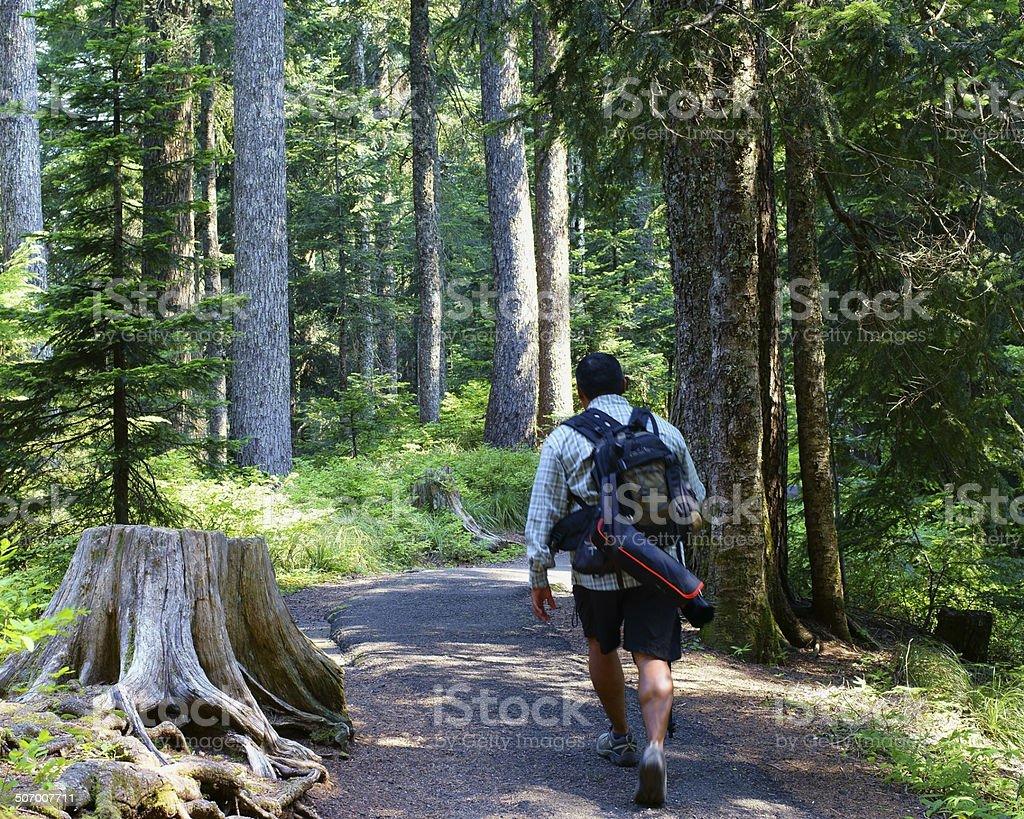 Male Photographer Hiking Toward Destination stock photo