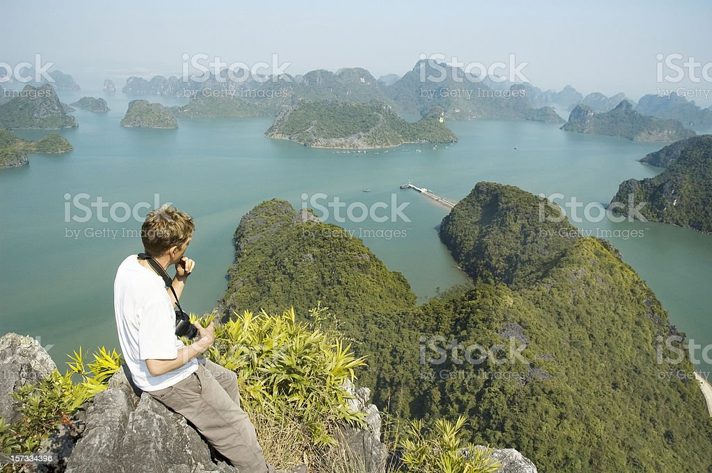 Male Photographer Looking At A View Of Halong Bay, Vietnam royalty-free stock photo