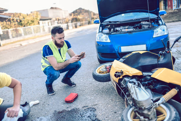 Male Photographing Damage In Traffic Accident stock photo
