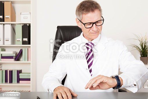 Male Physician Watching his Wrist Watch for Next Activity