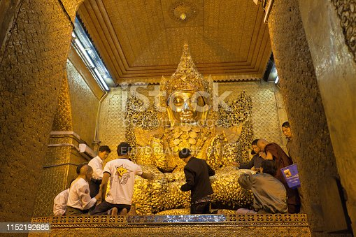 The Mahamuni Buddha Temple is a Buddhist temple and major pilgrimage site, located southwest of Mandalay, Myanmar. The Mahamuni Buddha image is deified in this temple, and originally came from Arakan. December 2011.