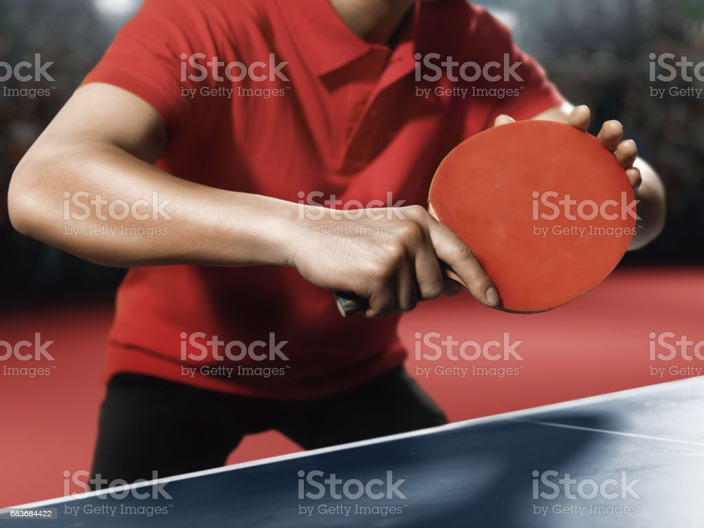 Male ping pong player holds a table tennis racket stock photo