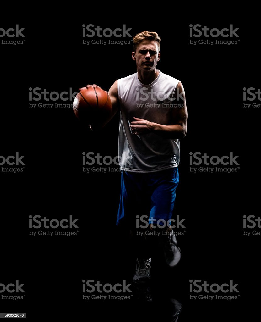 Male playing with basketball royalty-free stock photo