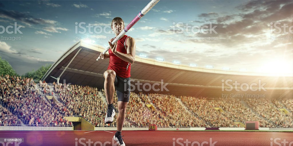 Male pole vaulting athlete stock photo