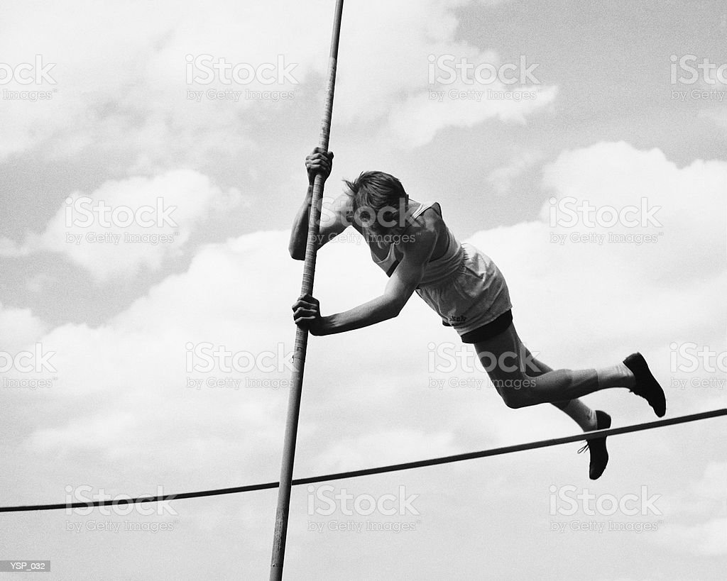 Male pole-vaulter clearing bar royalty-free stock photo