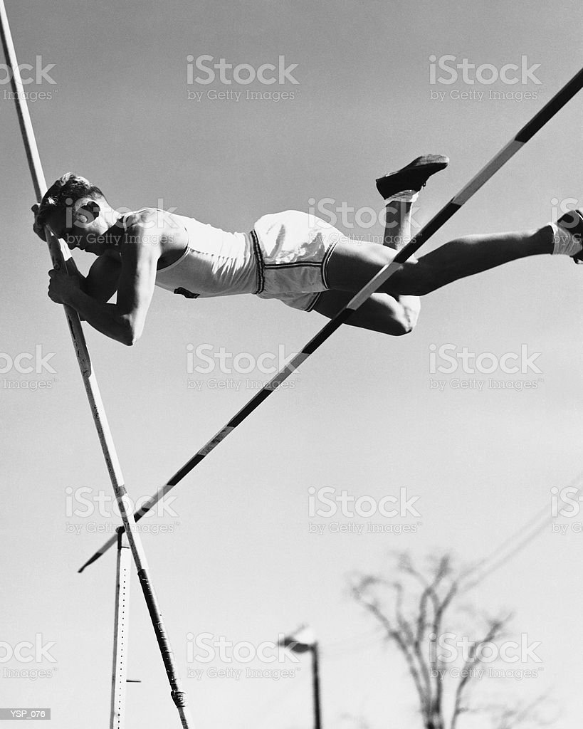 Male pole-vaulter clearing bar 免版稅 stock photo