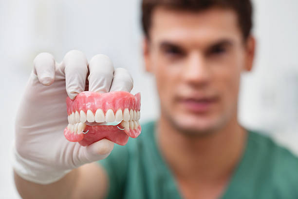 Male practitioner holding dental mold stock photo