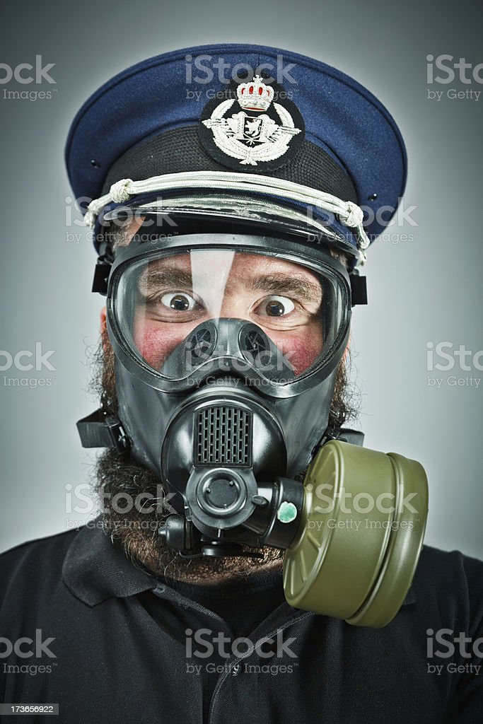 Male prepper wearing gas mask stock photo