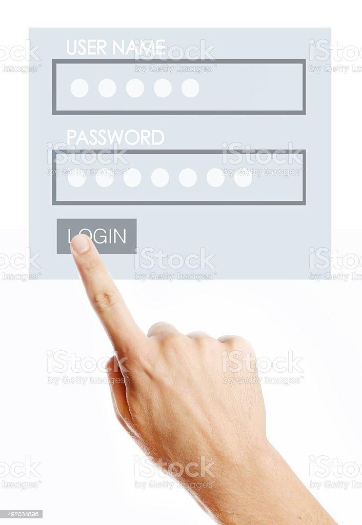 Male pressing login button on virtual screen stock photo