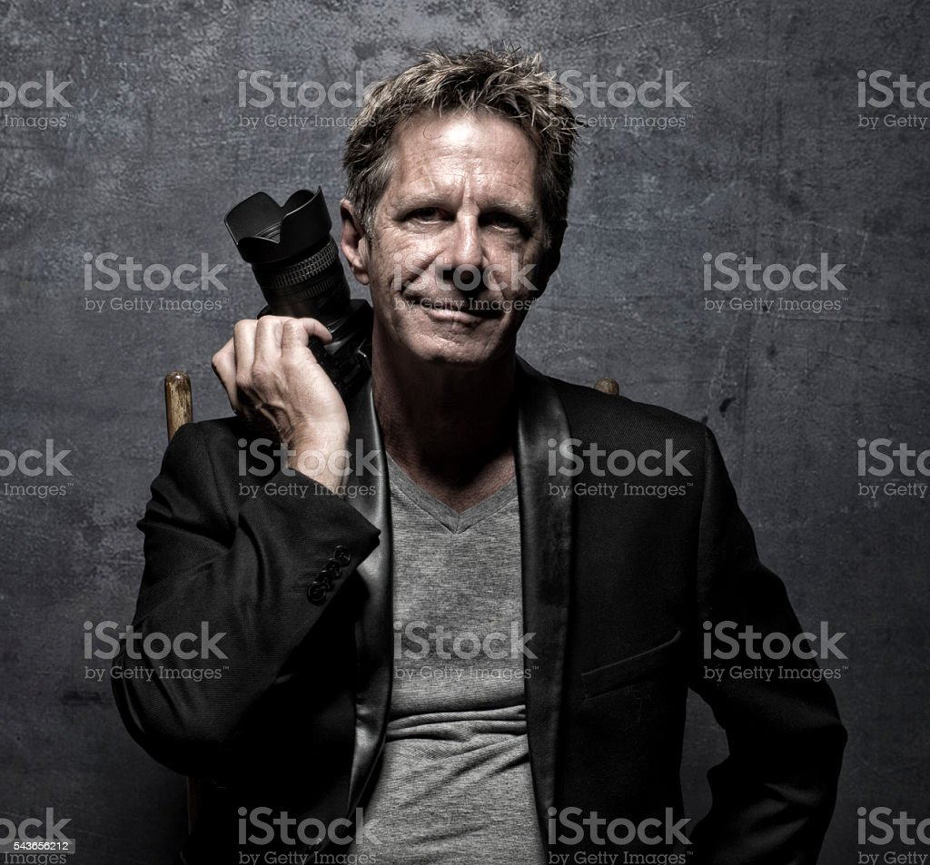 HDR Male Pro Photographer Holding His Camera stock photo