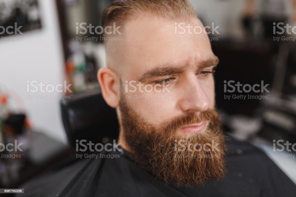Male Professional Hairdresser Serving Client. Ginger Handsome Brutal Stylish  Young Man With Thick Big Beard