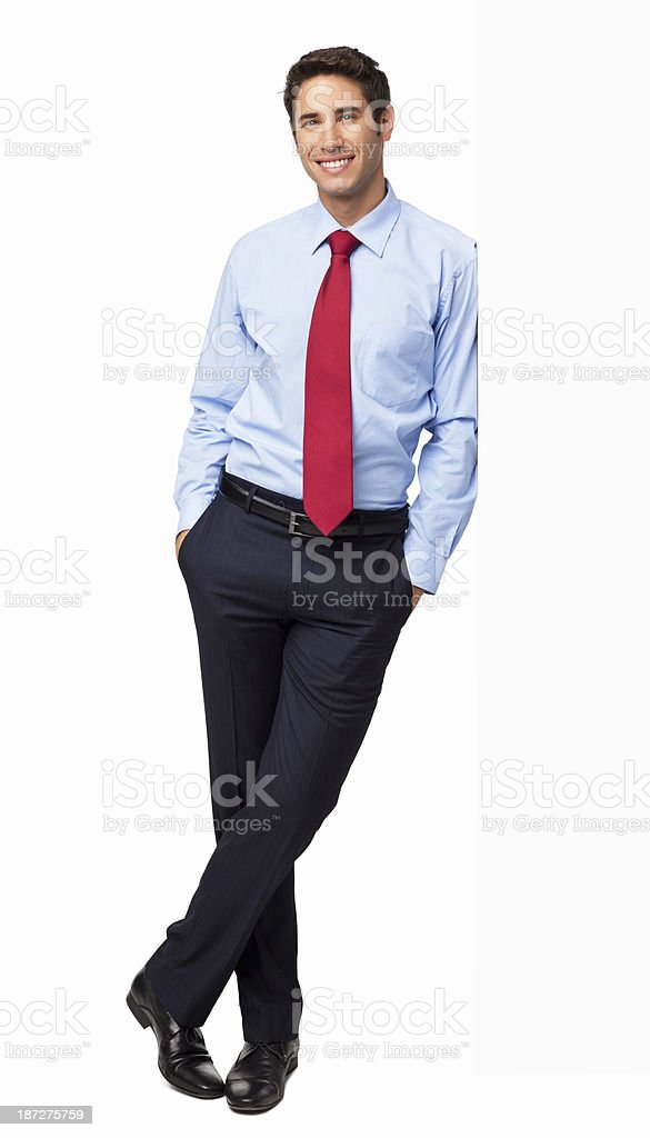 Male Professional Standing With Hands In Pockets - Isolated royalty-free stock photo