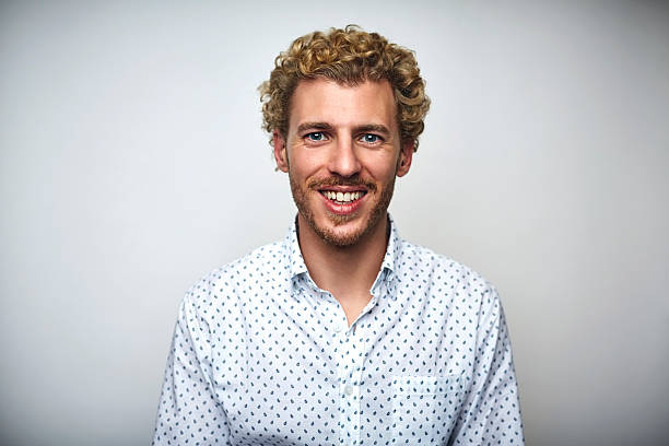 male professional with curly hair over white - cheveux blonds photos et images de collection