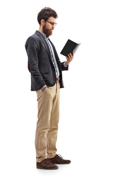 Male professor standing and reading a book Full length profile shot of a male professor standing and reading a book isolated on white background alternative pose stock pictures, royalty-free photos & images