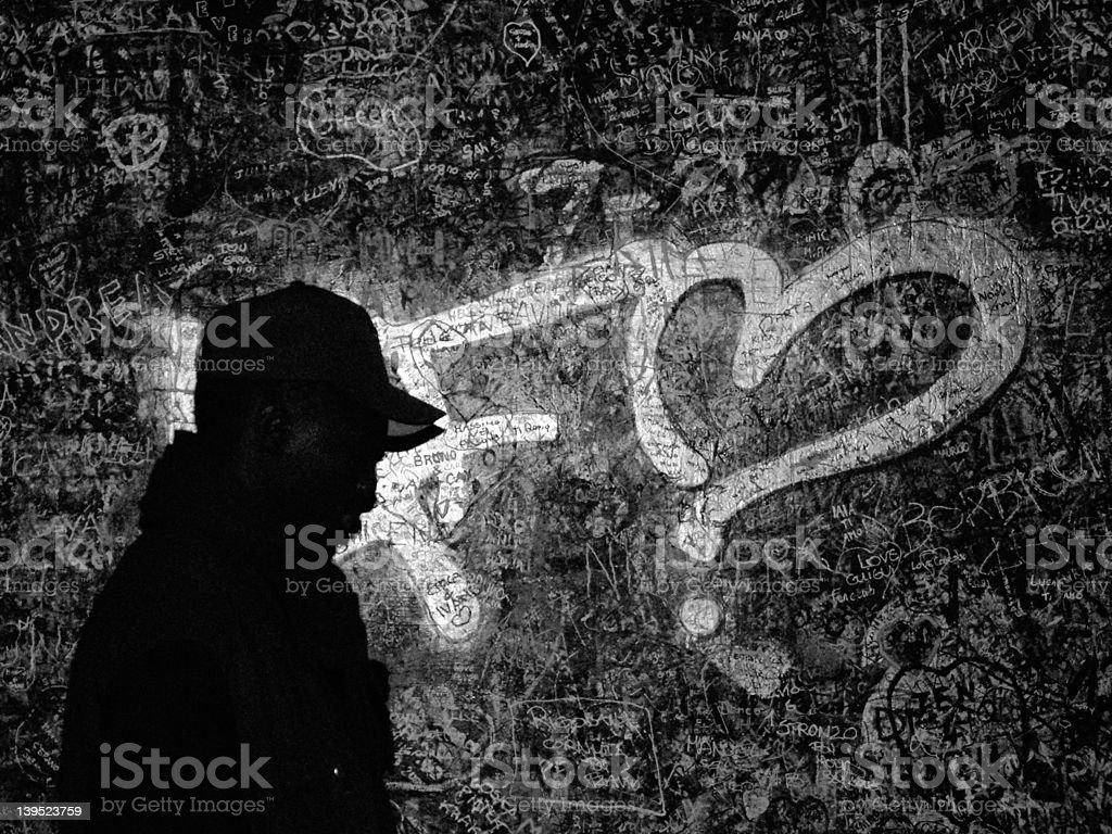 Male Profile on graffiti - Grainy stock photo