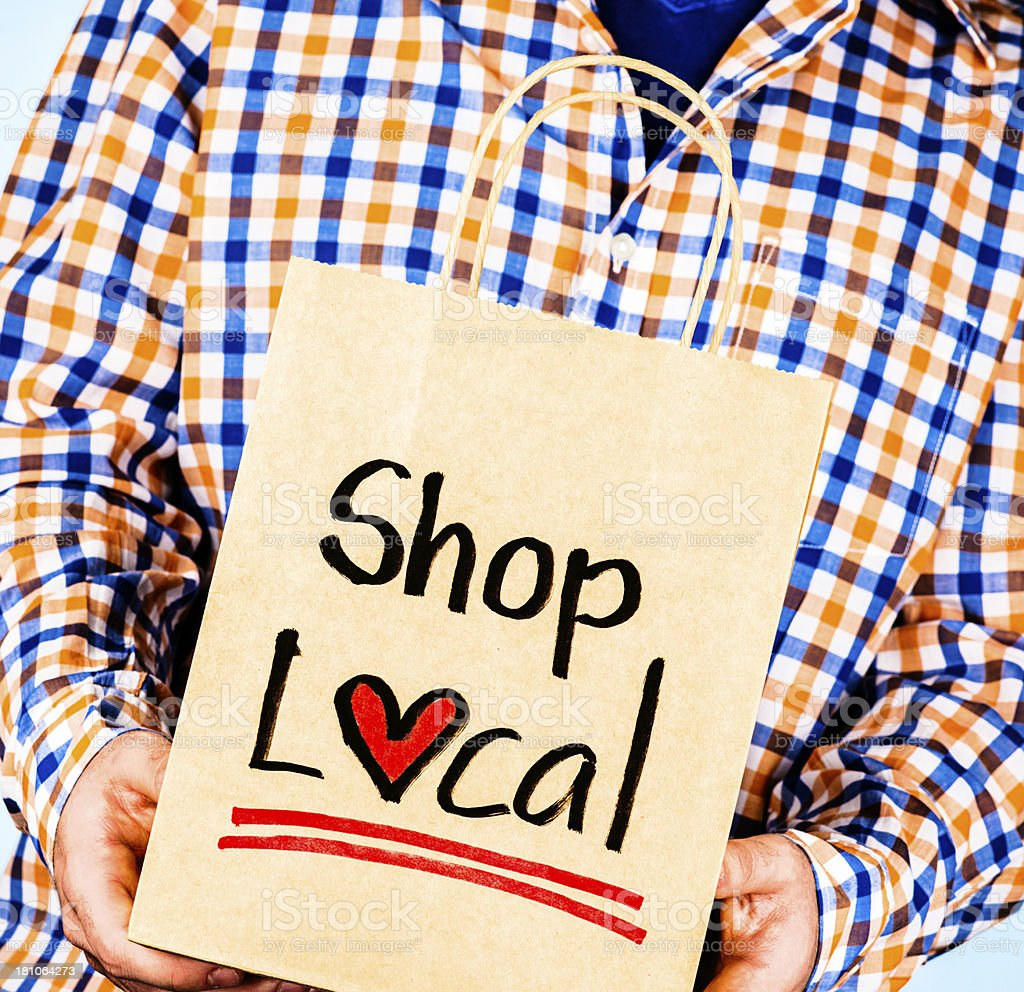 Male Promoting Shopping Locally royalty-free stock photo