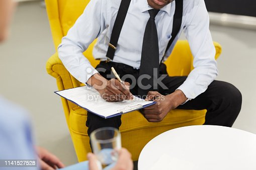 istock Male Psychologist Writing on Clipboard 1141527528