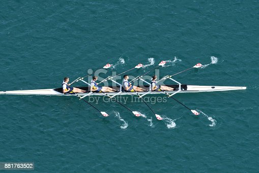 Upper view of quadruple scull rowing team during the race, Lake Bled, Slovenia