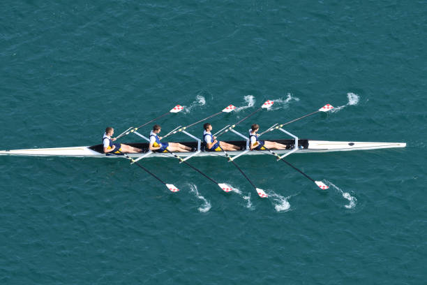 Male Quadruple Scull Rowing Team At the Race, Lake Bled, Slovenia Upper view of quadruple scull rowing team during the race, Lake Bled, Slovenia four people stock pictures, royalty-free photos & images