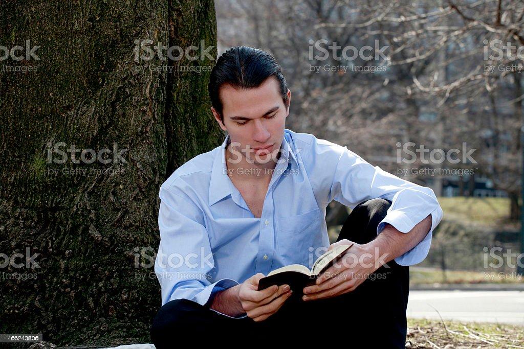 Male reading Bible stock photo