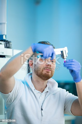 661098200istockphoto Male researcher carrying out scientific research in a lab 865628496