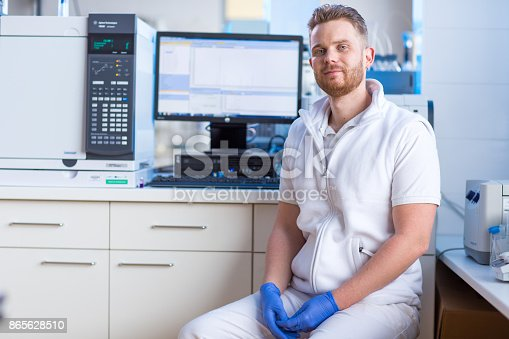 661098200istockphoto Male researcher carrying out scientific research in a lab 865628510