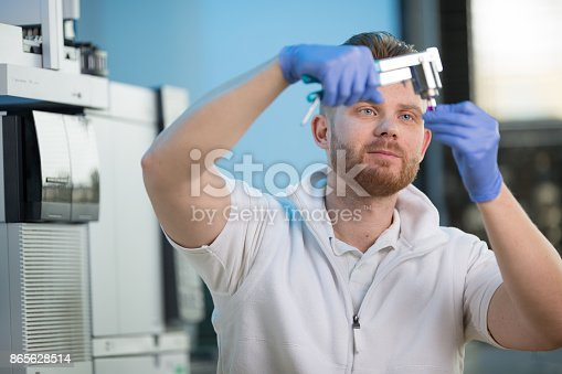 661098200istockphoto Male researcher carrying out scientific research in a lab 865628514