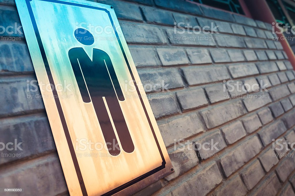 Male restroom sign stock photo