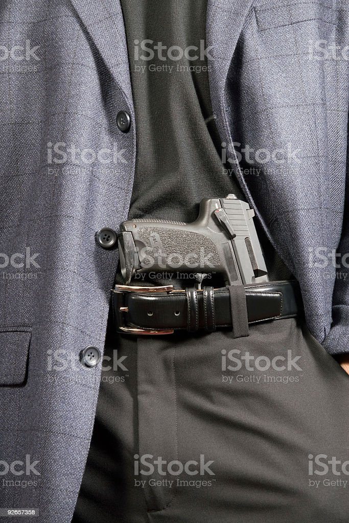 Male revealing gun in waistband royalty-free stock photo
