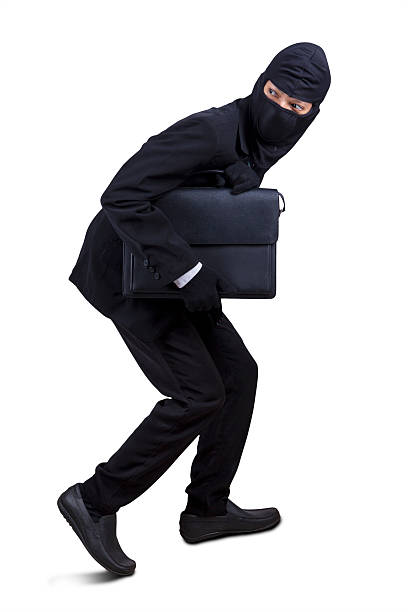 Male robber stealing a briefcase