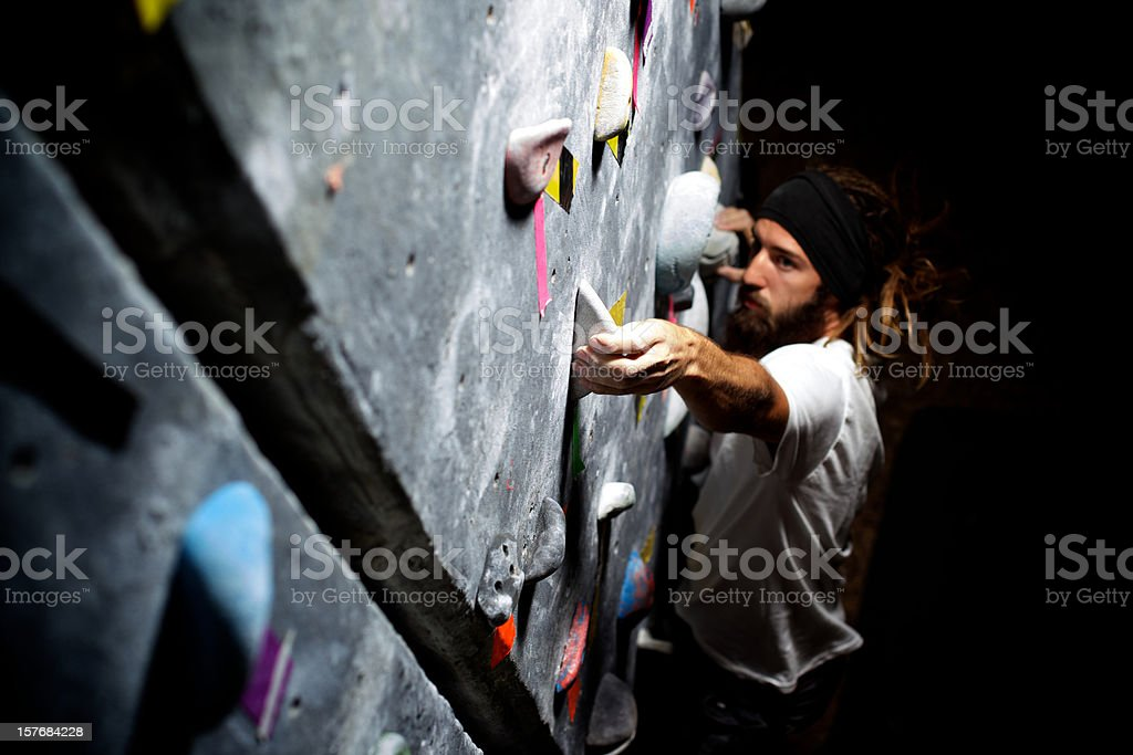 male rock climber climbing gym stock photo