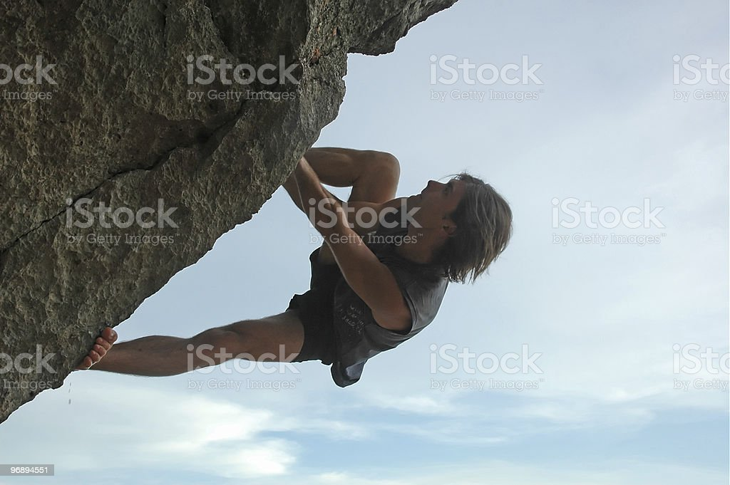 Male rock climber free climbing cliff overhang royalty-free stock photo
