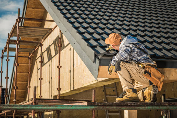 Male Roof Contractor Reviews Project Progress. stock photo