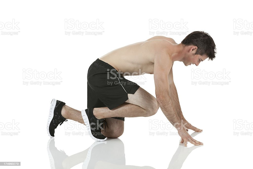 Male runner at the starting block before race royalty-free stock photo