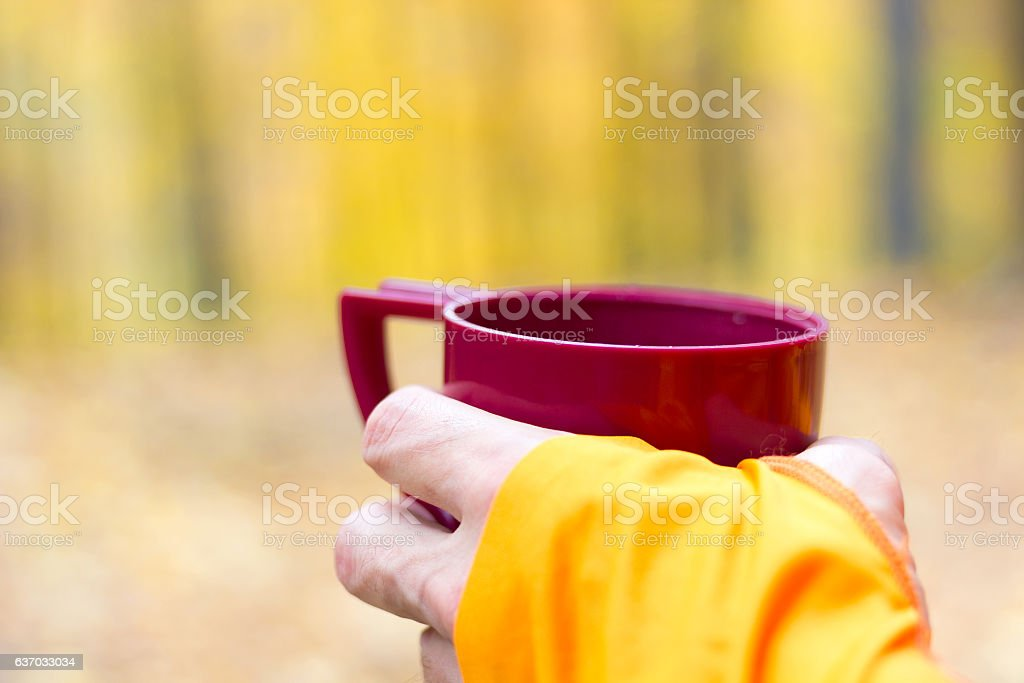 Male runner holding plastic thermos cup stock photo