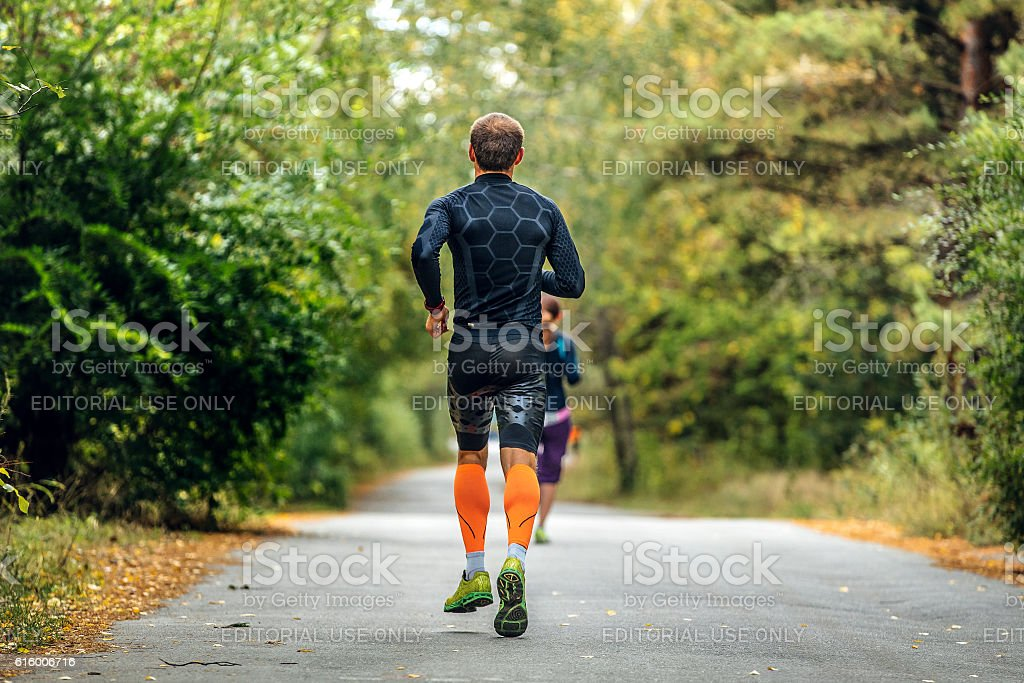 male runner in compression socks and clothes stock photo