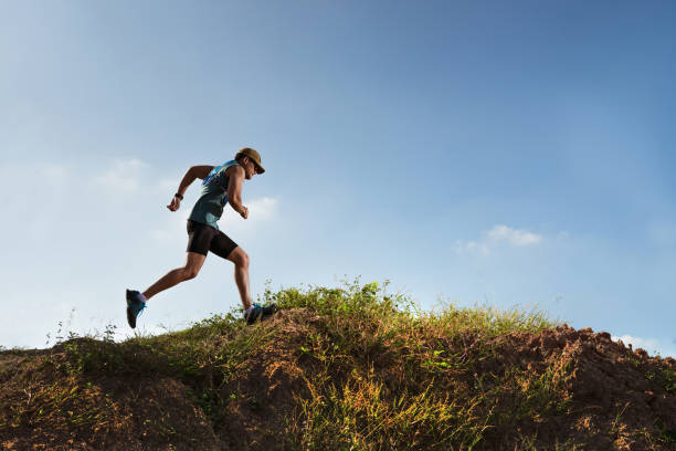 male runner of trail. he was running fast on the mountain - carpet runner stock photos and pictures