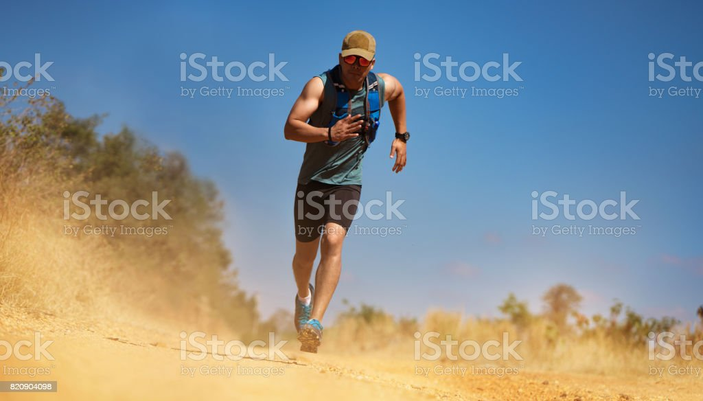 Male Runner of Trail. He was running fast stock photo